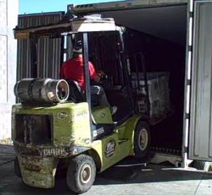 Loading produce onto a climate controlled container
